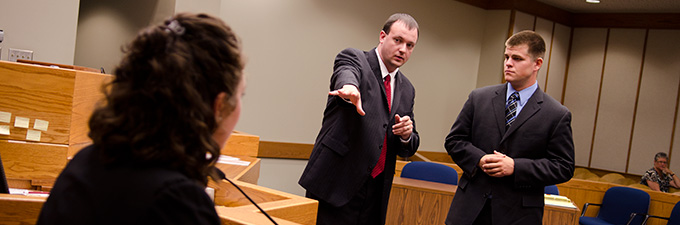 Mock trial student in courtroom